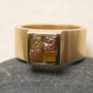 Gold ring with cubic rough diamonds: 2 are yellow and 2 are red. So glad that this one is on my daughters hand!