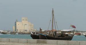 Boats in Dhow harbor, museum in the background