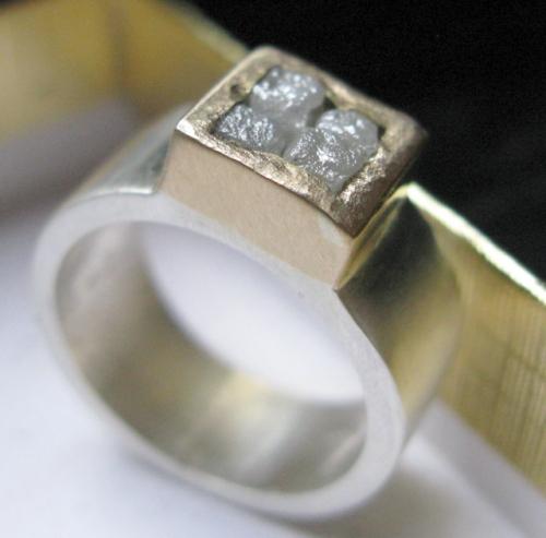 4 diamond cubes, 14K gold bezel, silver shank