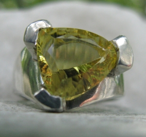Unusual citrine - nothing symmetrical about the facets done by and expert stone cutter.  The 3 pronged setting emulates the 'trillion' shape of the stone.