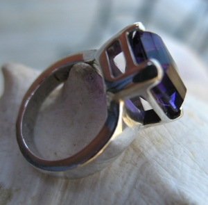 Just love that deep purple amethyst.  The basket setting is clunky and heavy to fit the massive stone.