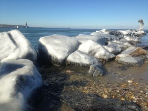 frozen rocks (by the channel entrance to 3 Mile Harbor)